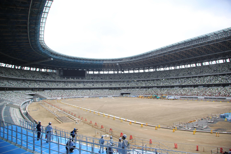 東奧主場館新國立競技場位於東京新宿,7月初完工約9成。東奧的開幕式、閉幕式、田徑賽將在這裡舉行,是3層樓建築,有6萬觀眾席,座位分5種顏色。(中央社檔案照片)